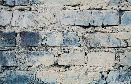 scuff: aged blue brick wall with cracks and scuffs, urban loft background