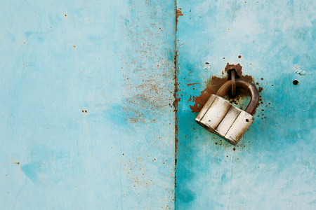outboard: outboard lock or padlock on vintage turquoise background, protection system concept, empty space for text