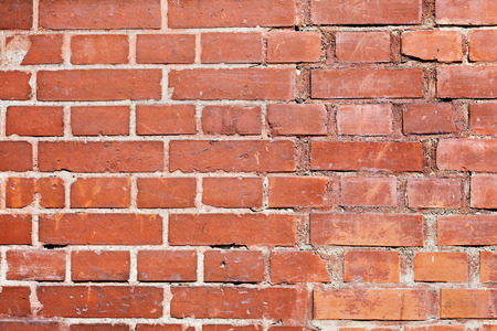 scuff: old red brick wall with cracks and scuffs, urban loft background