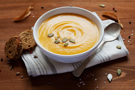 vegetable soup: Pumpkin soup in white bowl, dietary vegetable soup Stock Photo