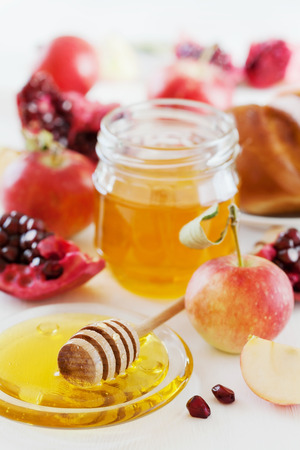 honey apple: Honey, apple, pomegranate and hala, table set with traditional food for Jewish New Year Holiday, Rosh Hashana Stock Photo