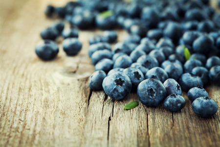 bog: Blueberry, great bilberry or bog whortleberry on wooden rustic board