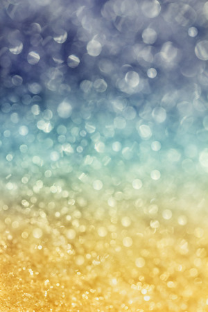 goldish: winter snow background with magic bokeh effect, glitter abstract festive background