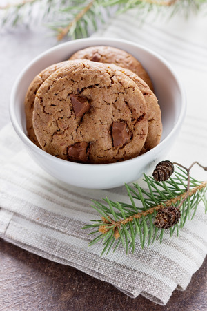 sweet pastries: sweet chocolate cookies or biscuit on rustic background, traditional American pastries