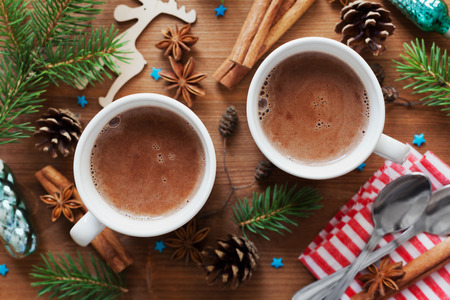 Two cups of fresh hot cocoa or hot chocolate on wooden christmas background, top view Stockfoto