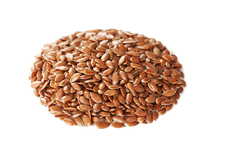 multiple objects: Closeup of flax seed or linseed isolated on white background