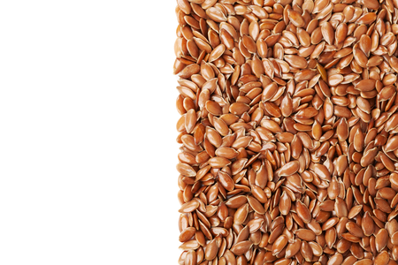 flax seed: Closeup of flax seed or linseed isolated on white background, top view