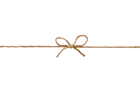 Closeup string or twine tied in a bow isolated on white background Фото со стока