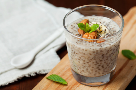 sweet: Chia seeds pudding with oat, banana and almonds decorated with mint leaves, vegetarian food