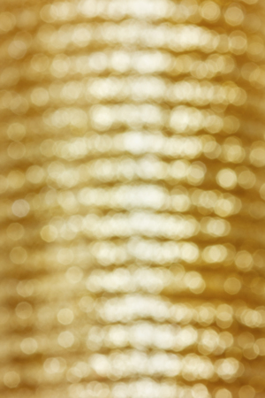 christmas backdrop: golden bokeh background, defocused holidays christmas lights on backdrop