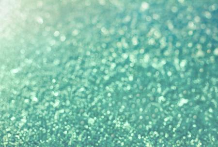 christmas backdrop: snow background in vintage toning, christmas light bokeh backdrop Stock Photo