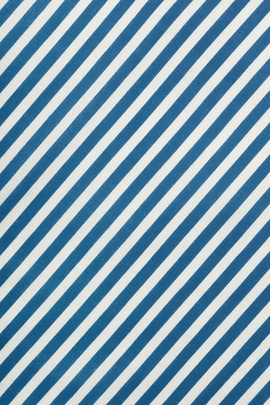 diagonal: Fabric background in diagonal blue and white stripe, cotton texture, top view