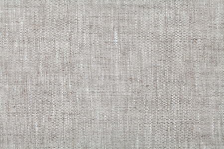 Fabric background in neutral grey color, linen texture, top view