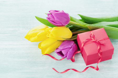 Spring flowers and gift box light table for March 8, International Womens day, Birthday or Mothers day 写真素材