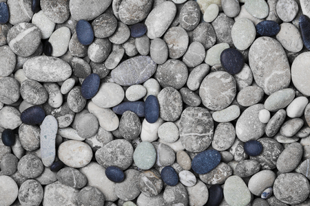 Black and gray pebbles for background for spa, natural macro texture, top view