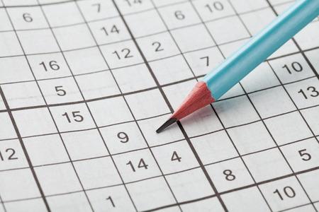 conundrum: Crossword sudoku and blue pencil for entertainment, popular conundrum
