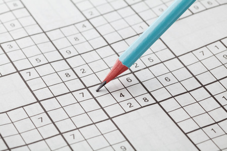 erudition: Crossword sudoku and blue pencil for entertainment, popular conundrum