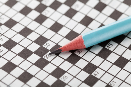 Crossword puzzle and blue pencil