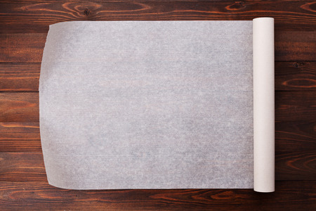 Baking paper on wooden kitchen table for menu or recipes, top view Banque d'images