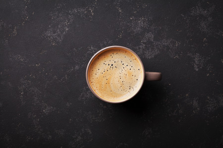 Cup of fresh coffee on vintage black table top view, flat lay Stock Photo