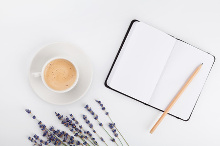Coffee, clean notebook and lavender flower on white table from above. Woman working desk. Cozy breakfast. Mockup. Flat lay style. Imagens - 68999145