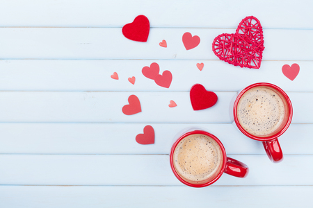 Two cup of coffee and mixed hearts on pastel blue table top view. Morning breakfast for Valentines day. Love concept. Stockfoto