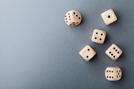 Top view of six wooden dice on table. Board game. Gambling devices. Stock Photo