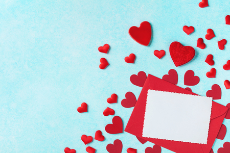 Valentines day background. Envelope, greeting card and red hearts for holiday message.