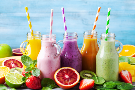 Summer colorful fruit smoothies in jars with ingredients. Healthy, detox and diet food concept.
