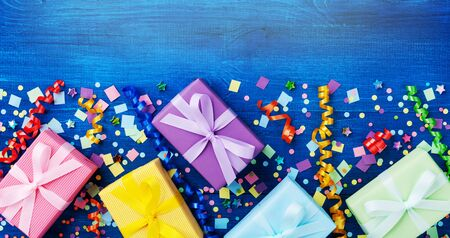 Holiday background with gift or present boxes and confetti. Birthday greeting card. Top view. Banner format. 스톡 콘텐츠
