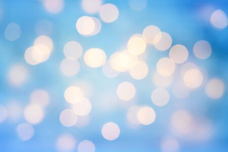 Bokeh background in blue color from holiday lights.