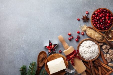 Ingredients for cooking Christmas baking. Flour, sugar, butter, cranberry and spices on table top view. Bakery background. Stockfoto