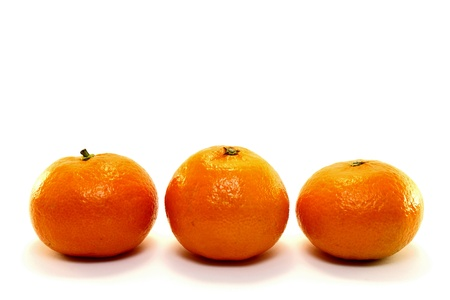 Three natural tangerine on white background