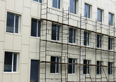 Scaffold against the wall and some windows
