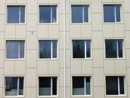 Several windows on the wall at the stage of building a new home