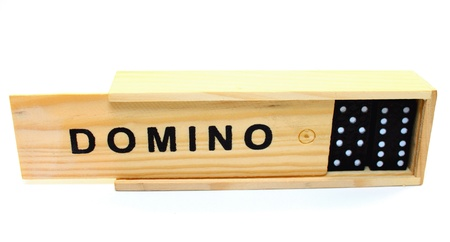 A box with dominoes on white background Standard-Bild