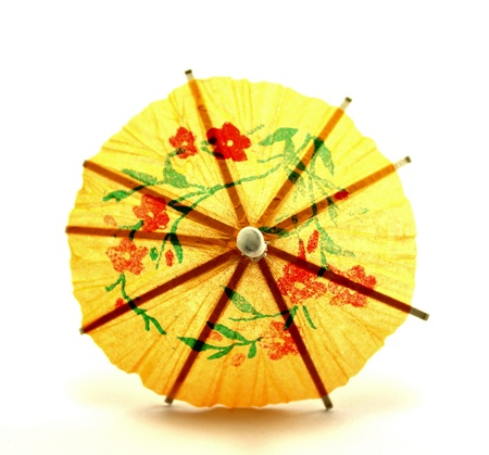 Yellow cocktail umbrella