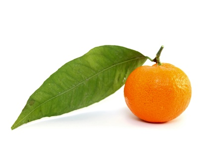 Juicy mandarin with green leaf photo