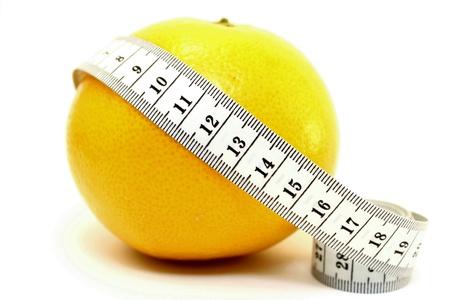 Fresh grapefruit with measuring tape