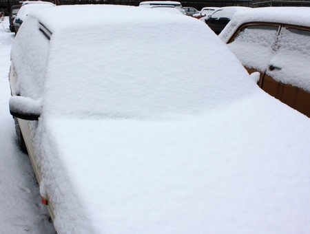 Snow-covered car windshield photo