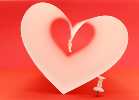 Beautiful abstract heart on red background photo