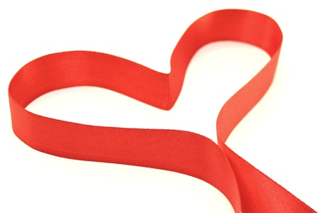 Beautiful heart from red satin ribbon Stock Photo - 12066668