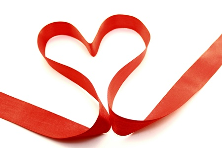 Beautiful heart from red satin ribbon  photo