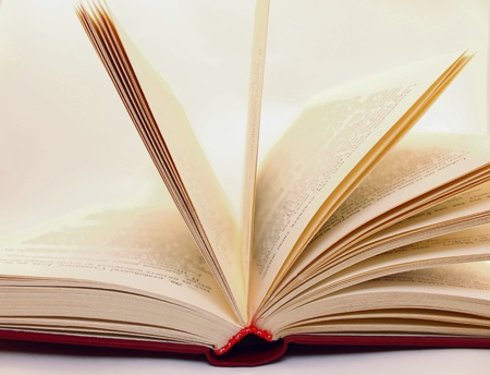 Old book in expanded form close Stock Photo