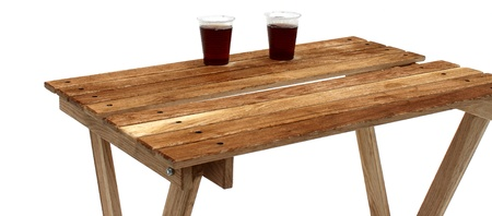 Two plastic cups of tea on wooden table