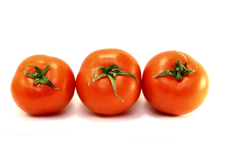 Juicy red ripe tomatoes on a white background Stock Photo - 12820296