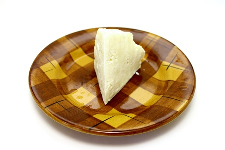 A delicious cheese on a plate closeup on white background Stock Photo - 12821125