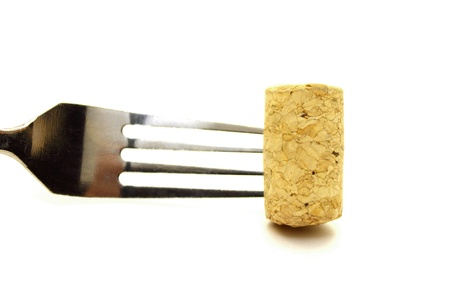 Fork and cork closeup on white background photo