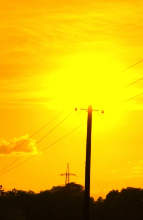 Electric pole in the sun photo