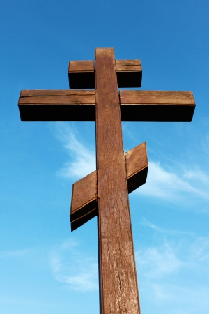 The wooden cross on a blue sky background photo